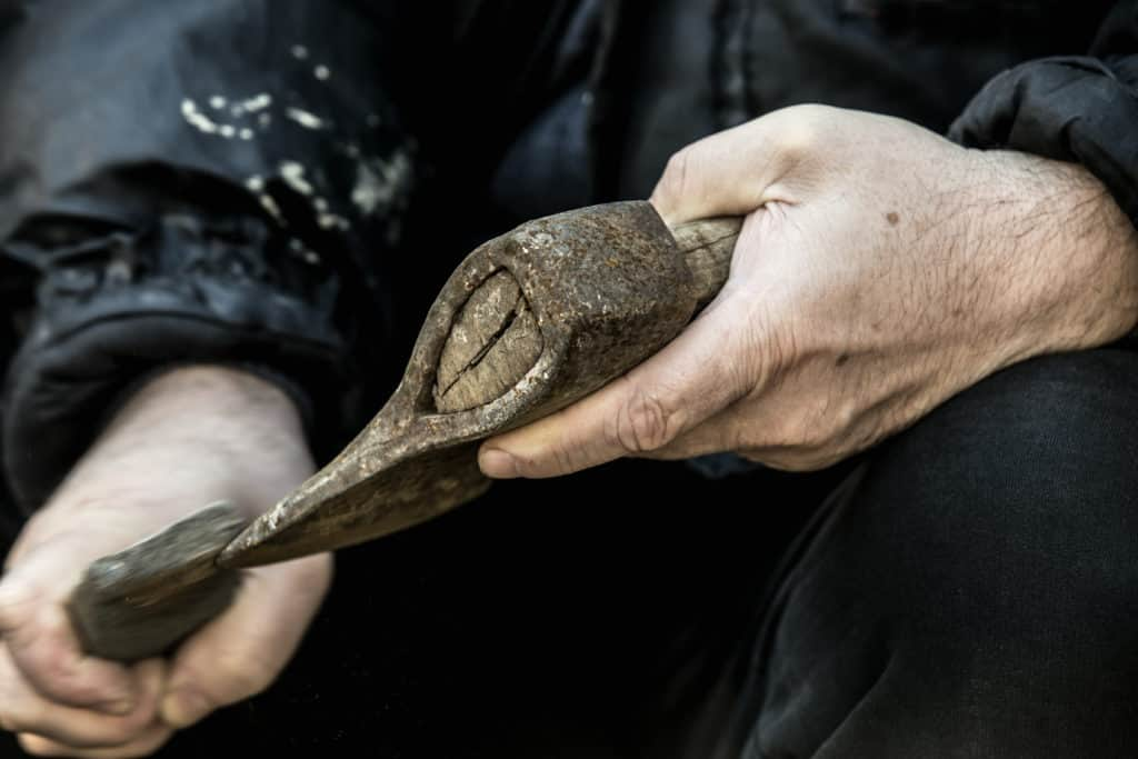 Sharpening a hatchet with a whetstone