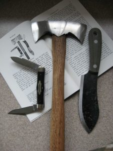 A Nessmuk trio of double bit hatchet and fixed-blade and folding knives